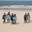 alumnos de la escuela surf Llanes con las tablas en la playa