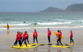 escuela de surf llanes, cursos de surf